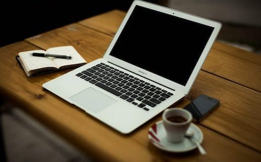 photo of laptop and coffee, 3 reasons you must update your website blog on Digital Pizza CT